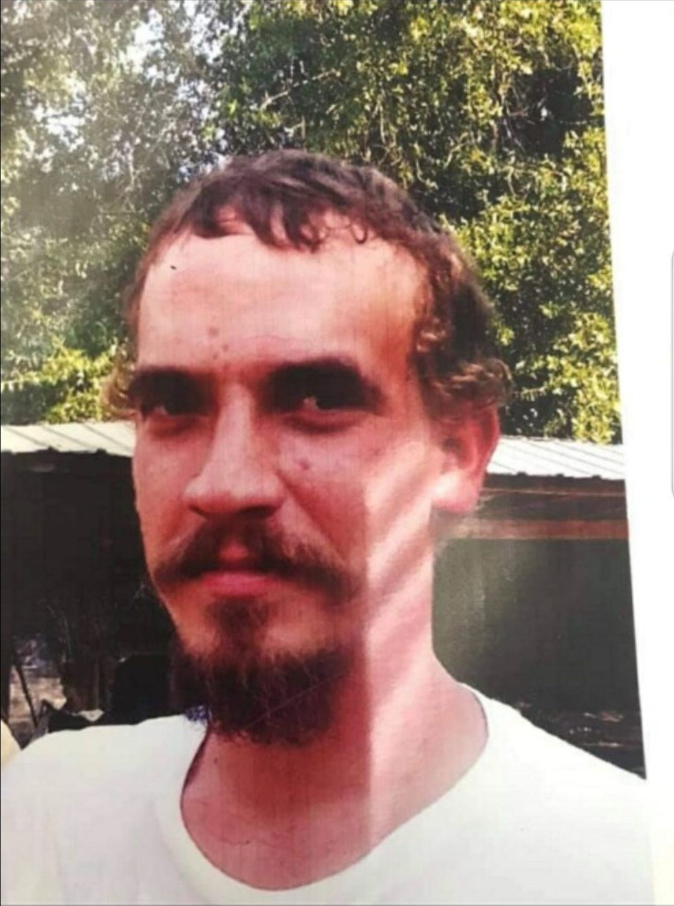 35-year-old Brett Joshua Grantham's body was buried on land off Peak Road in Holmes County.