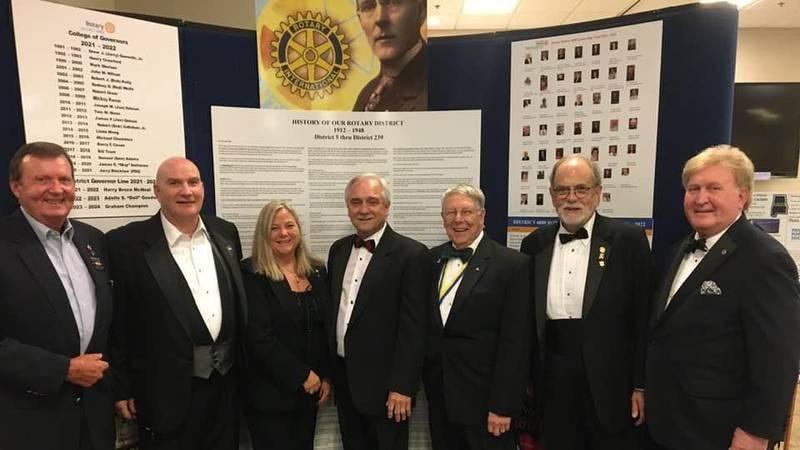 Left to Right: Bob Mills District Treasurer, Tom Mann past District Governor (PDG), Dell...