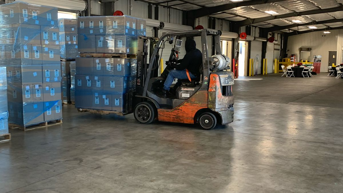 Forklift worker moving pallets at Old Dominion