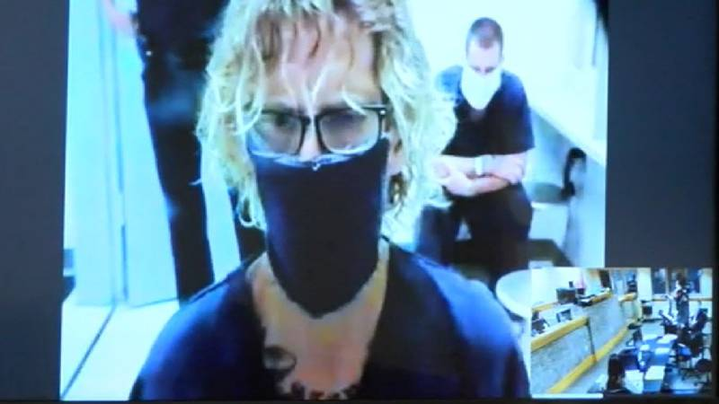 Hutto appeared via video teleconference in his first appearance in court to face manslaughter...