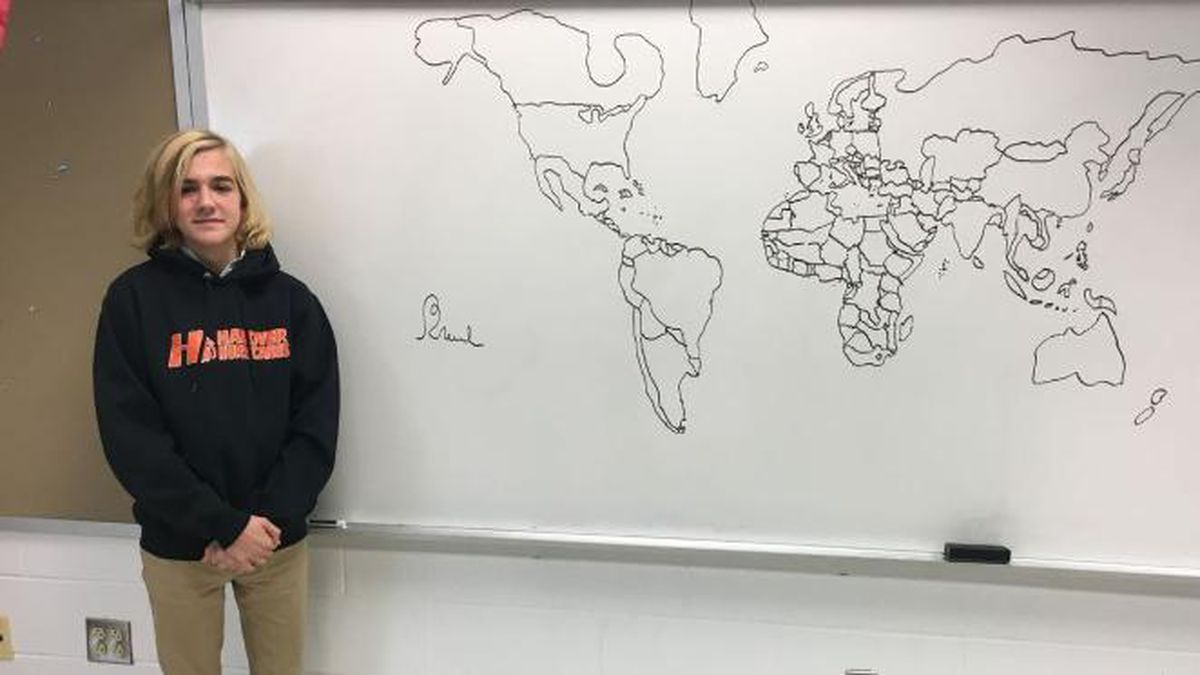 Brooks Tunstall standing in front of his map drawing (Source: NBC12)