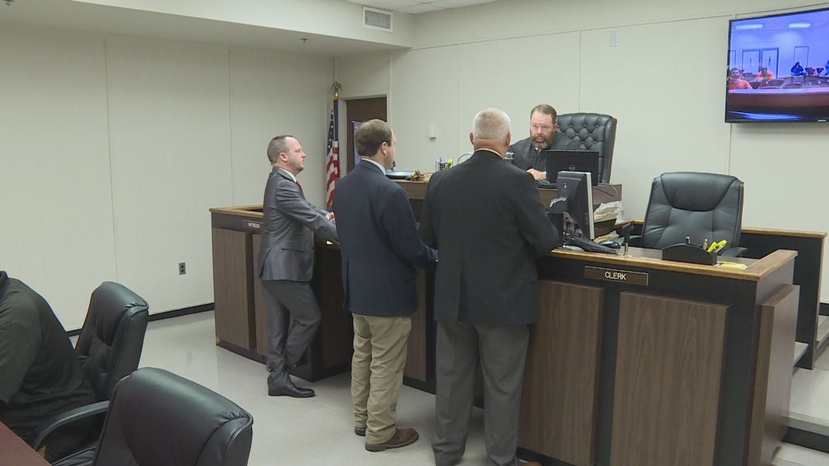 Houston County Judge Benjamin Lewis hears testimony before setting bond for a murder suspect.  Pictured (L-R) are attorney Shaun McGhee, Assistant District Attorney Jarrod Blumberg, and Dothan police officer Keith Cook.