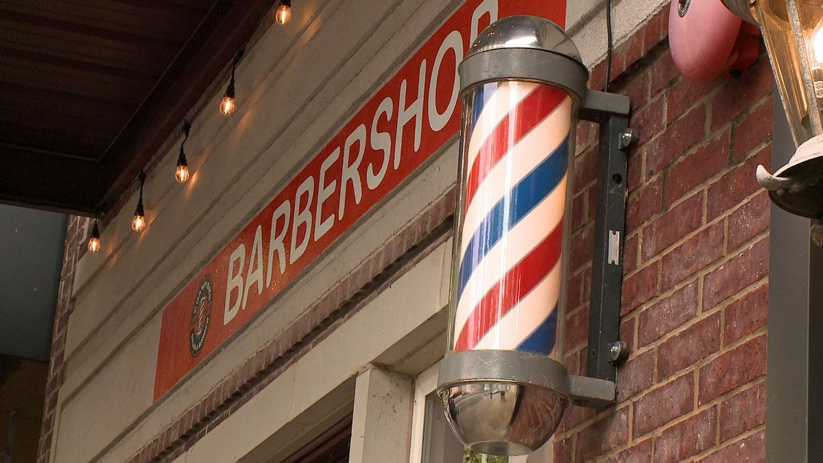 The owners of Champions Salon & Barber in downtown Waco, Kevin and Lorraine Gritten, applied Friday morning. (Photo by Bill Gowdy)