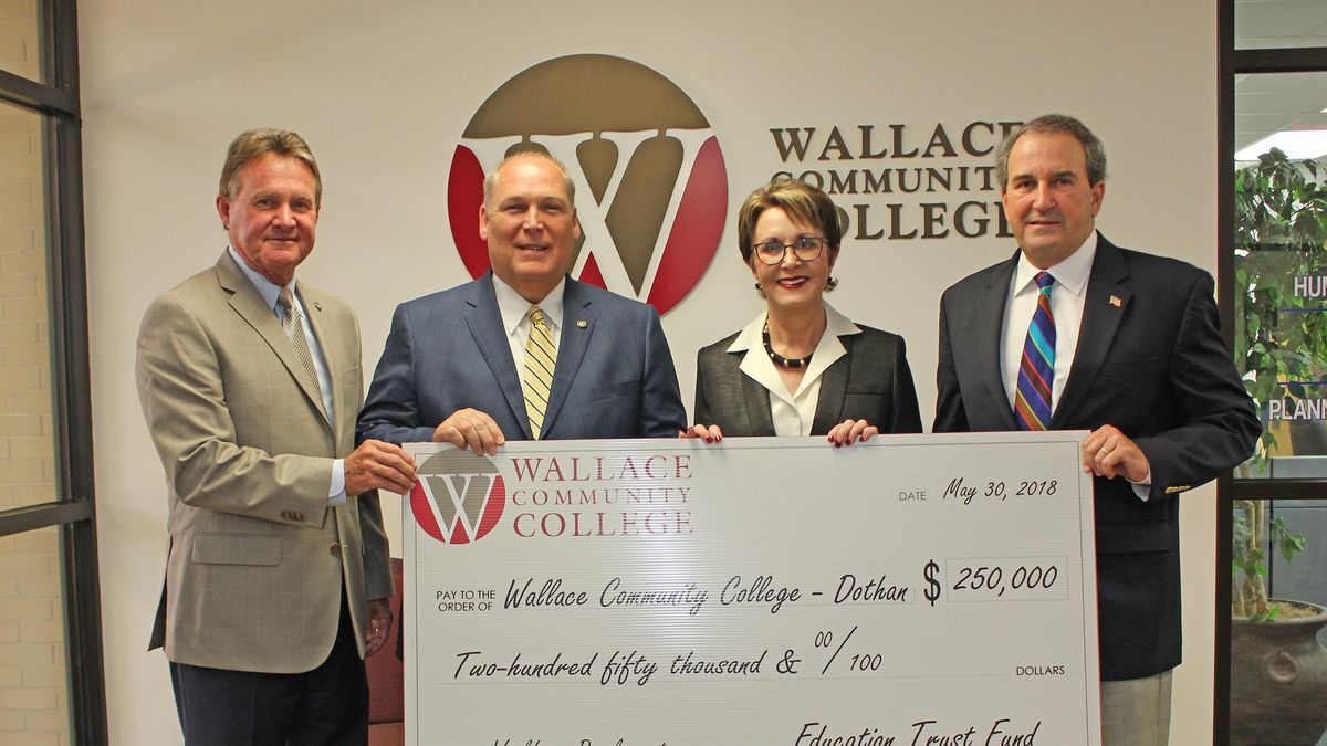 (L-R): State Representatives Donnie Chesteen and Paul Lee, Dr. Linda C. Young, WCCD president, and State Representative Steve Clouse. (photo: Wallace Community College)