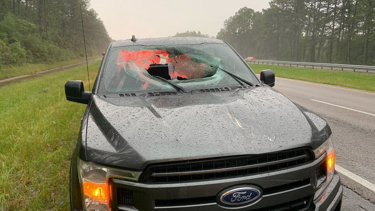 Walton County firefighters say a chunk of the road flew through a pickup truck's windshield...