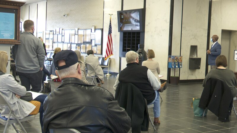 An overflow crowd watches on closed circuit monitor as the Dothan Planning Commission considers...