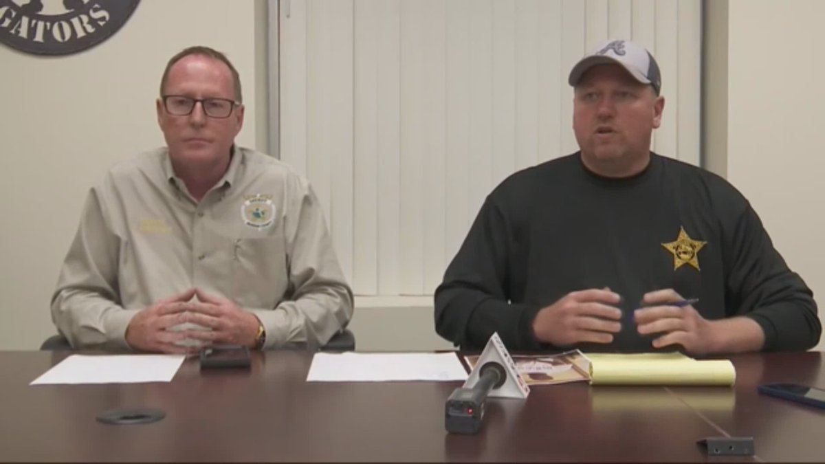 Holmes County Sheriff John Tate (L) and Jackson County Sheriff Donnie Edenfield speak to...