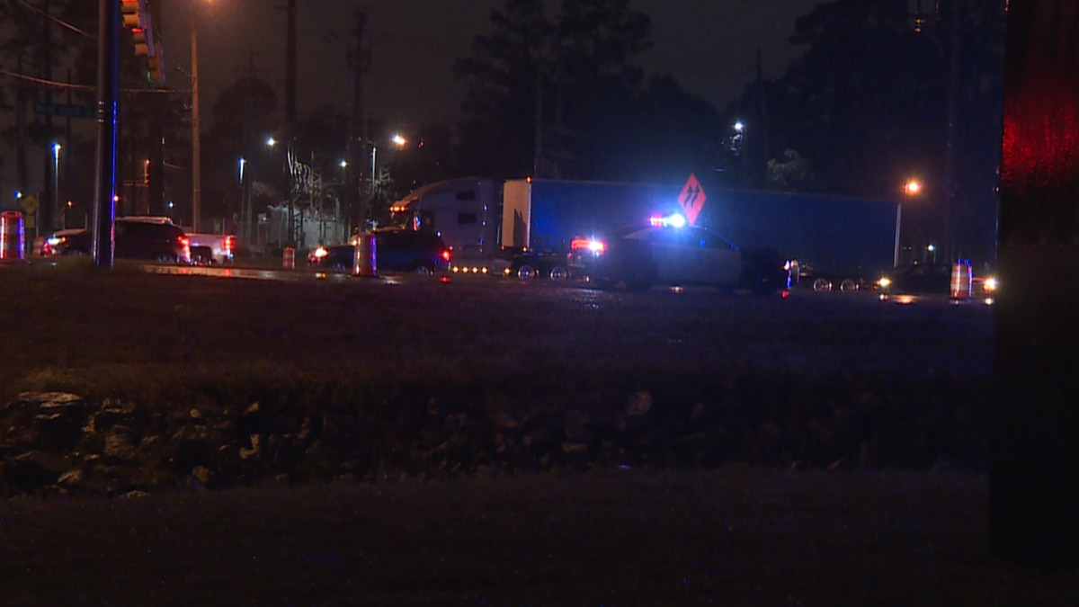 A car struck a Dothan police officer as he directed traffic after a wreck on Ross Clark...