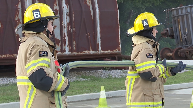Women's Safety Initiative: General fire safety. Participants geared up in firefighter suits and...