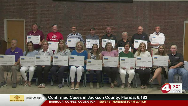 Dothan Diamond Classic awards check to participating schools