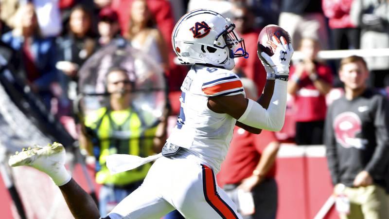 Auburn receiver Ja'Varrius Johnson (6) scores a touchdown against Arkansas during the first...