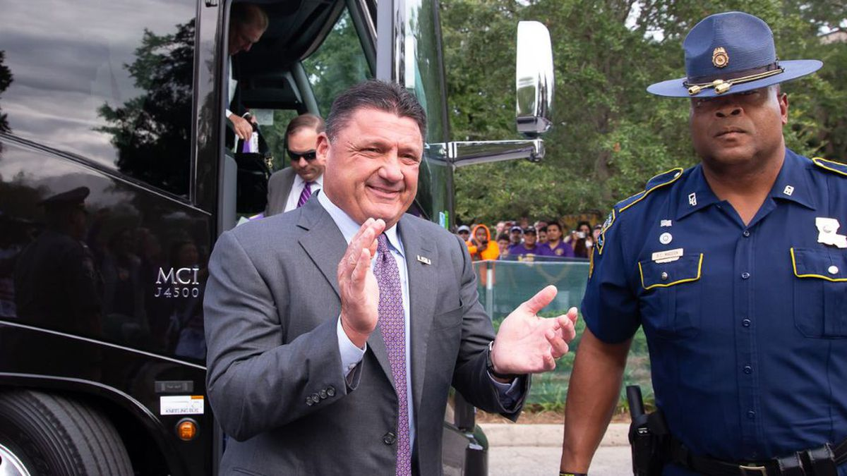 State trooper Bryan Madden protects Coach Orgeron on gamedays. (Source: Mark LaGrange)