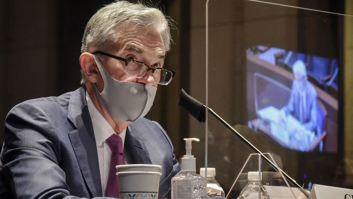 Federal Reserve Board Chairman Jerome Powell, reflected in the sneeze guard set up between himself and members of the House Committee on Financial Services, speaks during a hearing on oversight of the Treasury Department and Federal Reserve pandemic response, Tuesday, June 30, 2020 on Capitol Hill in Washington.