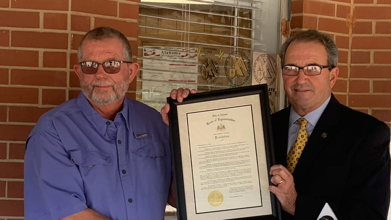 Level Plains Mayor Bruce Grantham receives resolution from State Rep. Steve Clouse for his...