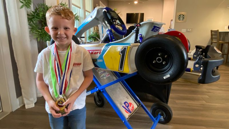 Six-year-old Camdon Clay of Panama City Beach shows off some of his racing medals.