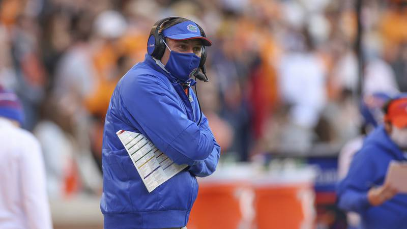 Florida head coach Dan Mullen looks on during the first half of an NCAA college football game...