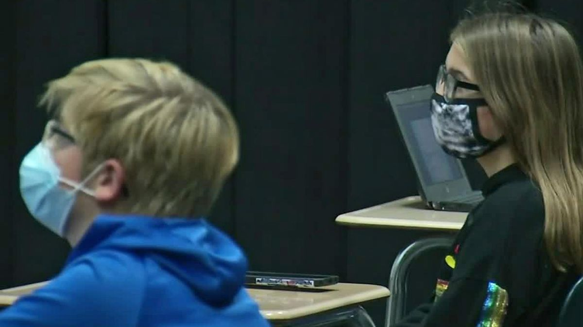 (File Photo) Students at a school in Bellevue wear masks during classes amid the ongoing novel...