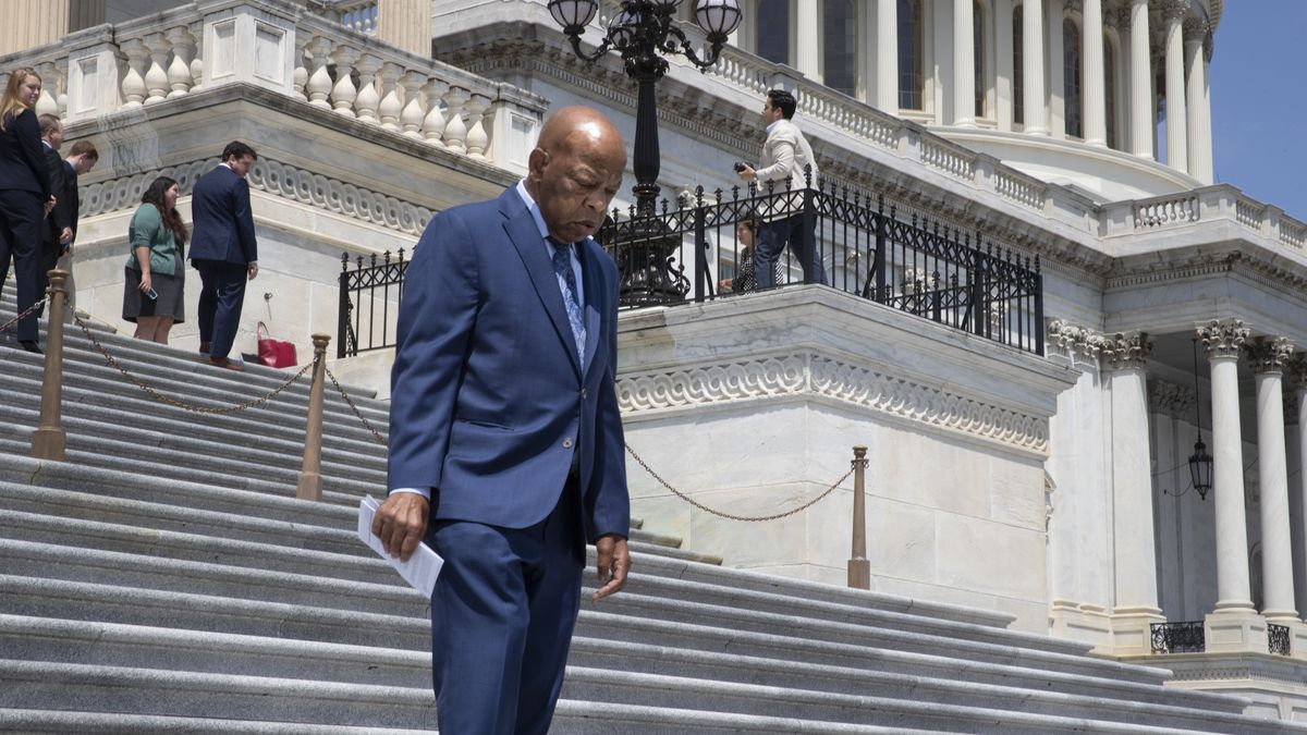 In this photo taken Thursday, July 26, 2018, Rep. John Lewis, D-Ga., walks down the steps of the House of Representatives following final votes as lawmakers break for the August recess, at the Capitol in Washington. The 78-year-old civil rights icon was hospitalized for undisclosed reasons in Atlanta for undisclosed reasons, Saturday night, July 28, 2018. (AP Photo/J. Scott Applewhite)