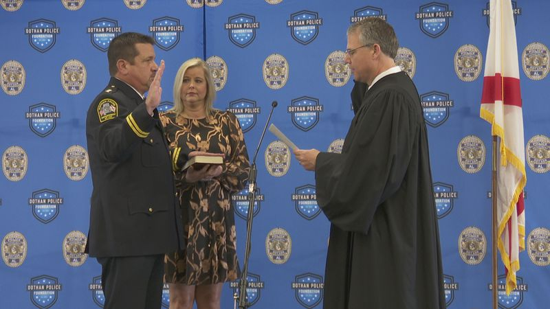Newly appointed Dothan Police Chief Will Benny is sworn in by Alabama Supreme Court Justice...
