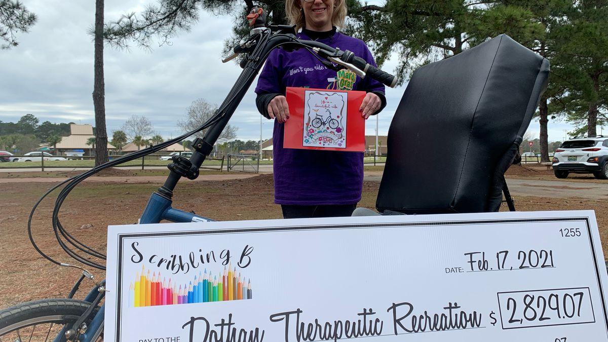Brandi Deese presents $2,829.07 to Dothan Leisure Services Therapeutic Program