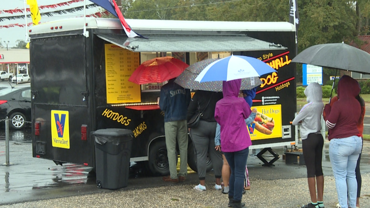 Sixteen food trucks and vendors took part in the event, handing out barbecue, hamburgers,...