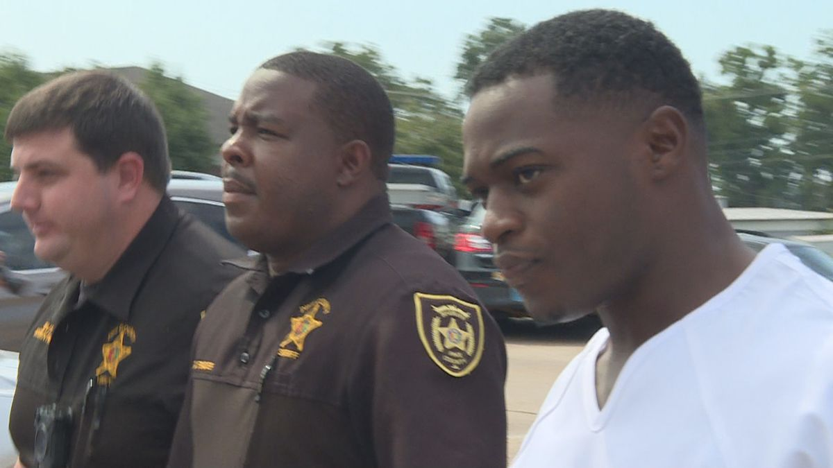 Murder suspect Leon Terrell Flowers is escorted by officers to the Pike County courthouse in...