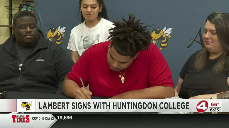 On the dotted line: Ashford's Lambert signs with Huntingdon