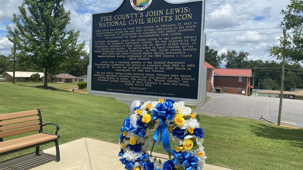 A wreath lays beside the John Lewis Historical Marker in Troy.