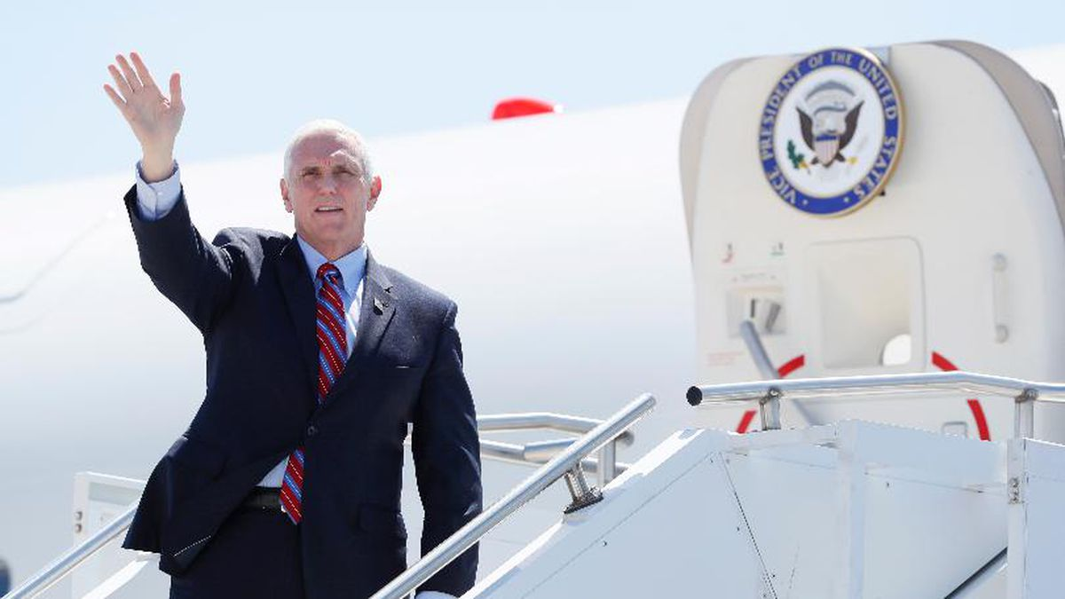 Vice President Mike Pence waves as he stops off Air Force Two after arriving at the Des Moines International Airport before meeting with faith leaders and food industry executives in response to the coronavirus pandemic, Friday, May 8, 2020, in Des Moines, Iowa. (Source: AP)