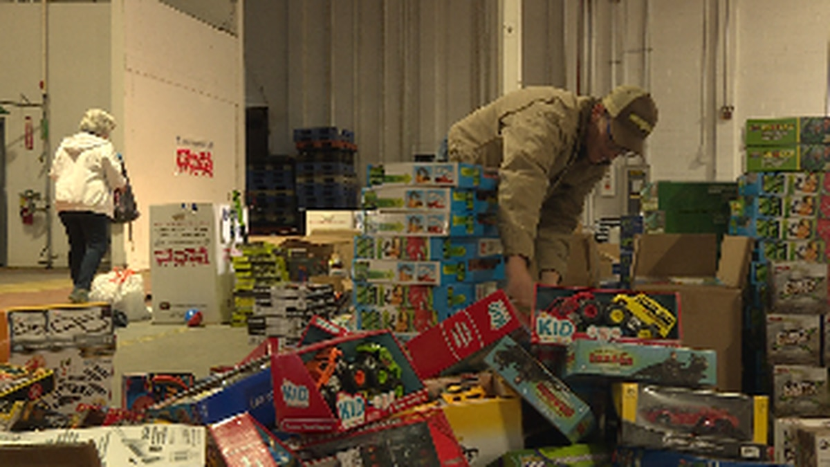 Volunteers sort and choose toys to send to over 2,000 local children.