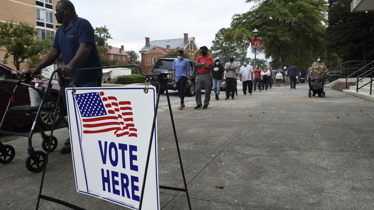 Monday was the first day for advance voting in Georgia and people showed up by the hundreds to cast their ballot early at the Bell Auditorium in Augusta, Ga., Monday, Oct. 12, 2020  (Michael Holahan/The Augusta Chronicle via AP)