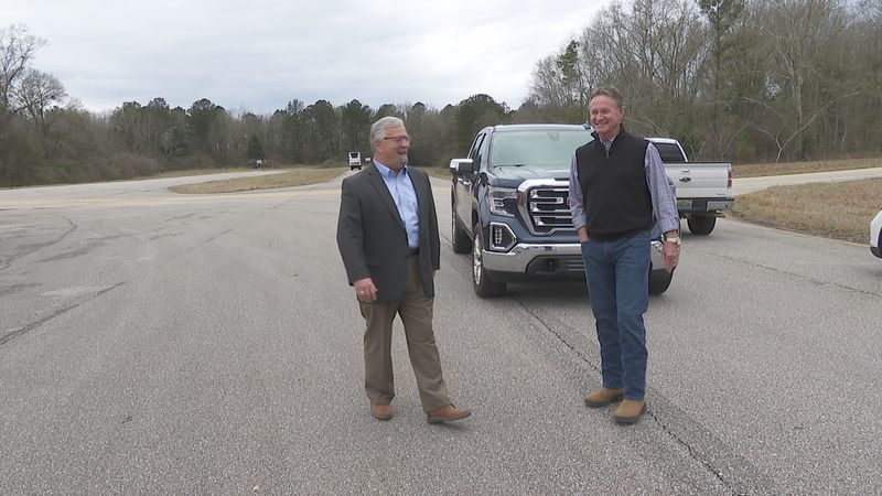 Rep. Jeff Sorrells (L) and State Senator Donnie Chesteen discuss plans to widen Alabama Highway...