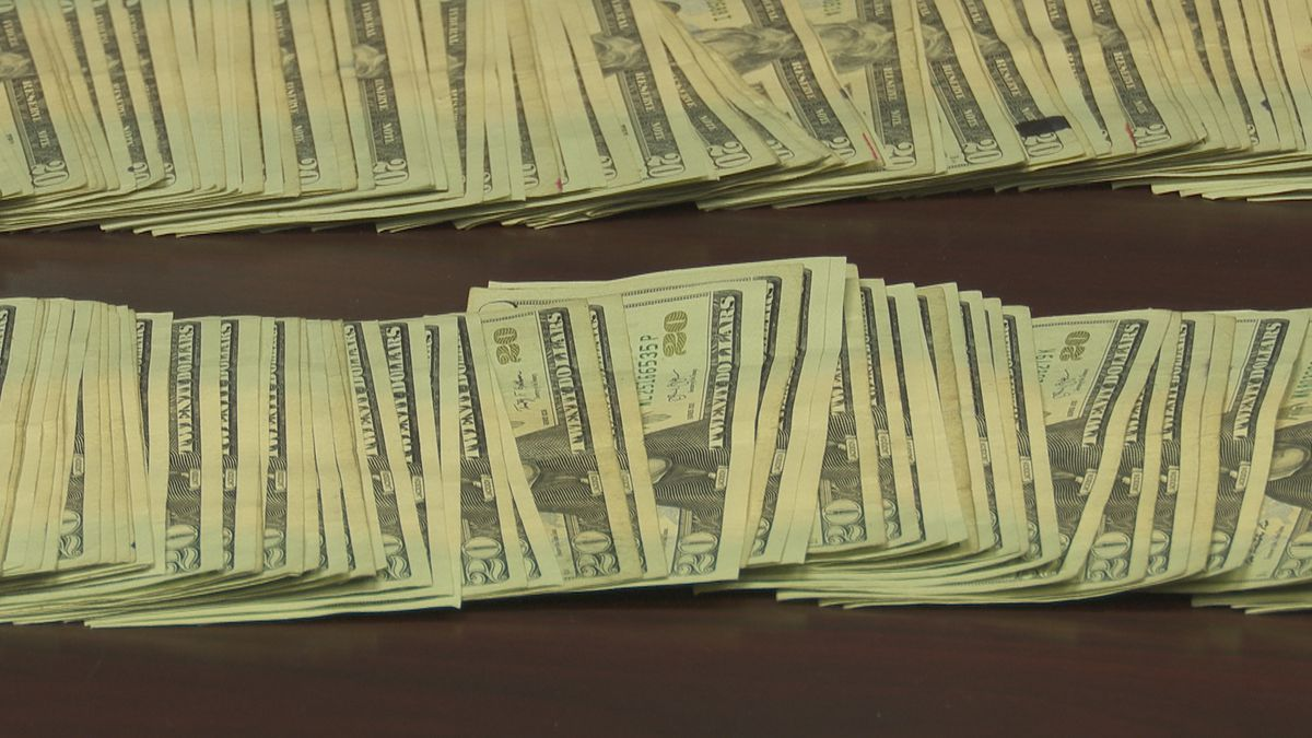 Drug raid results in seizure of thousands in cash and pounds of pot