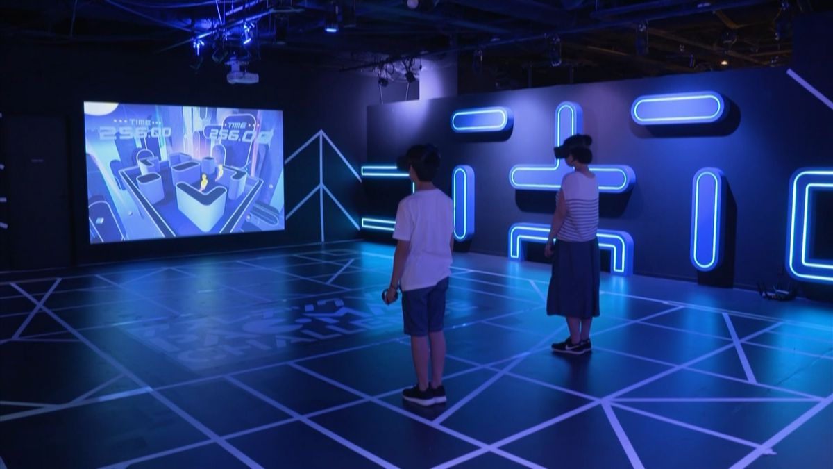 To the naked eye, the gameplay area appears to be a group of squiggles on the floor, but once the VR goggles are on, players are transported to a maze area where they must run around and capture the balls while avoiding the ghosts.<br />Courtesy: AP