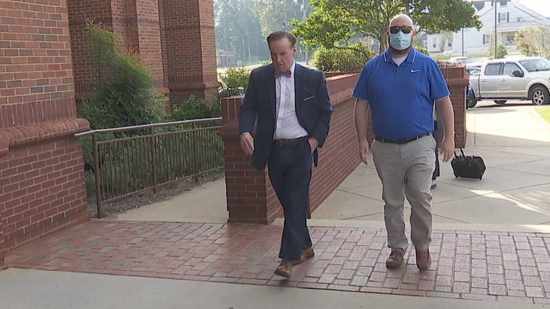 Jason Greathouse (R), charged with rape, walks into the Coffee County, AL courthouse, with...