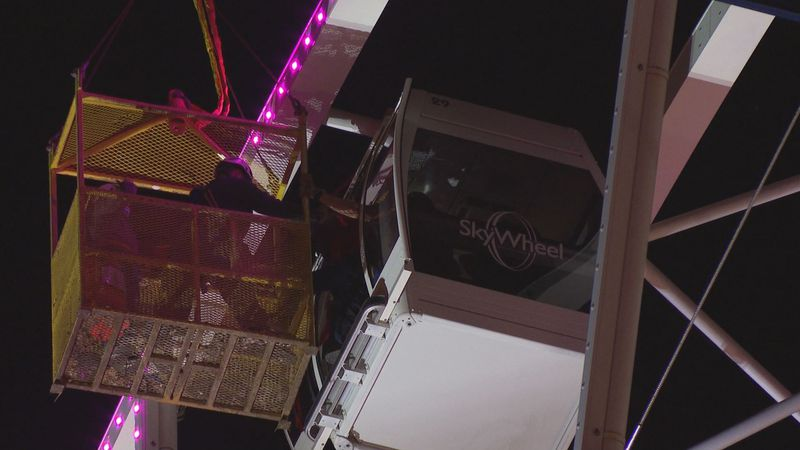 Six tourists found themselves stranded in a SkyWheel boxcar more than 180 feet dangling in the...