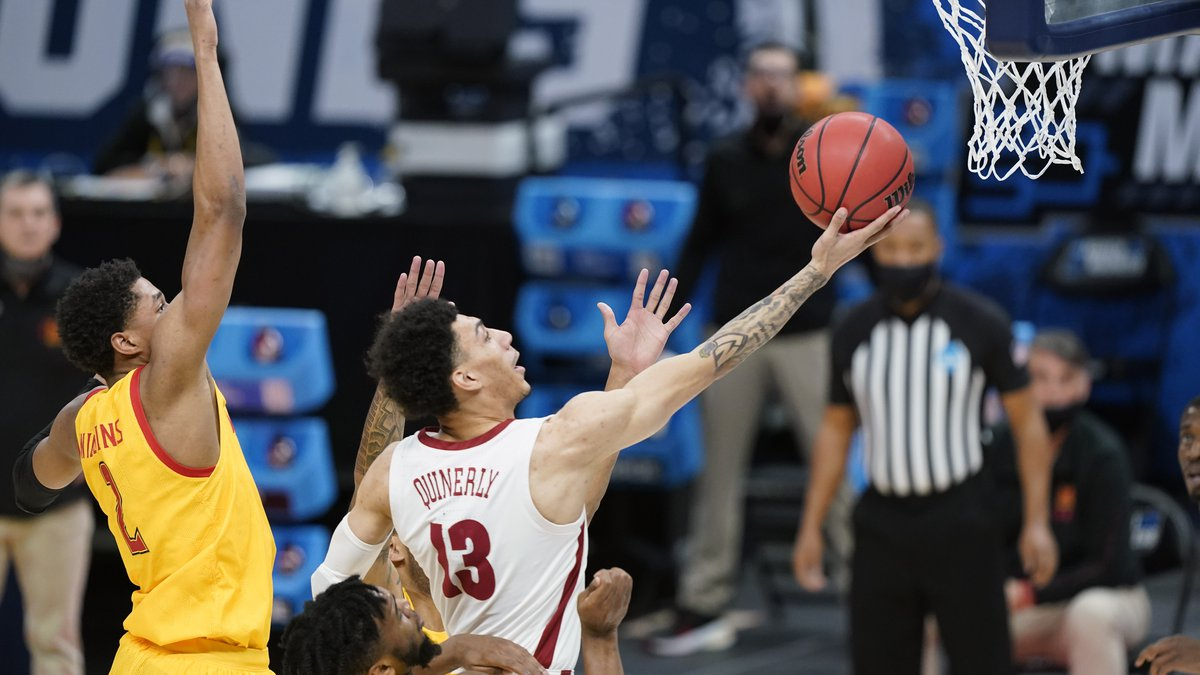 Alabama's Jahvon Quinerly (13) scores ahead of Maryland's Aaron Wiggins (2) during the first...
