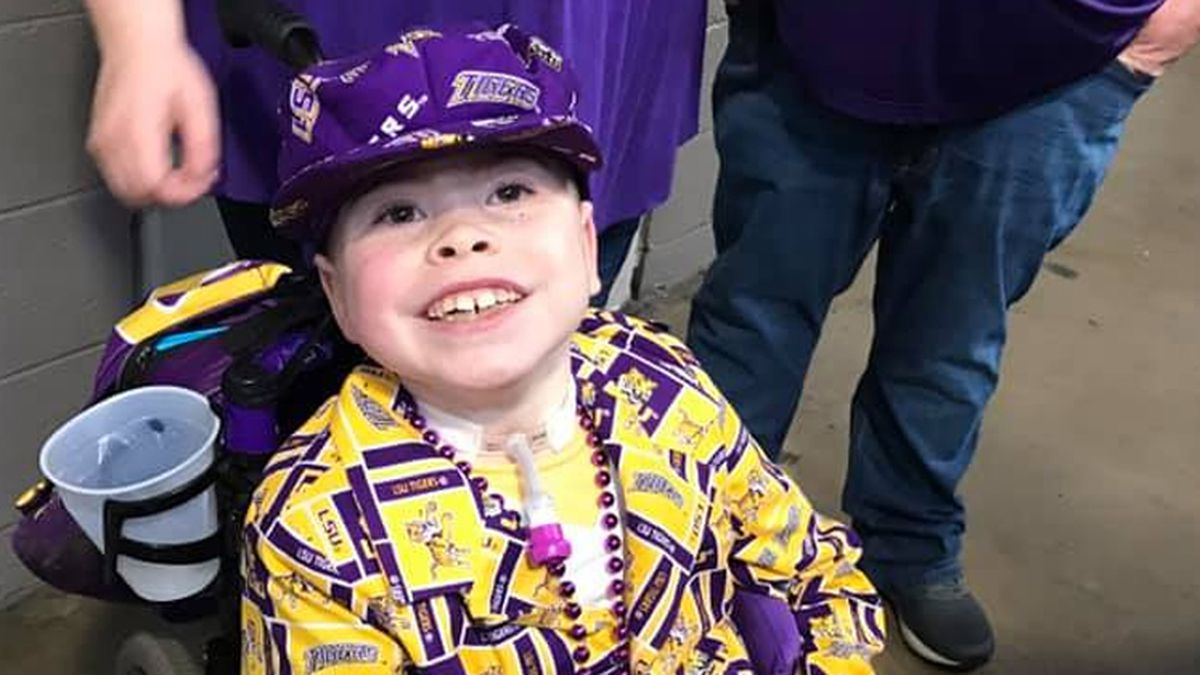 Colton Moore, 9, was gifted tickets to see the game and was decked out in a LSU-themed outfit for Monday night's game. (Source: Colton Moore Facebook page)