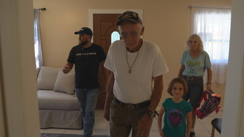 A former military veteran and his family receive a special home dedication after it sustained...