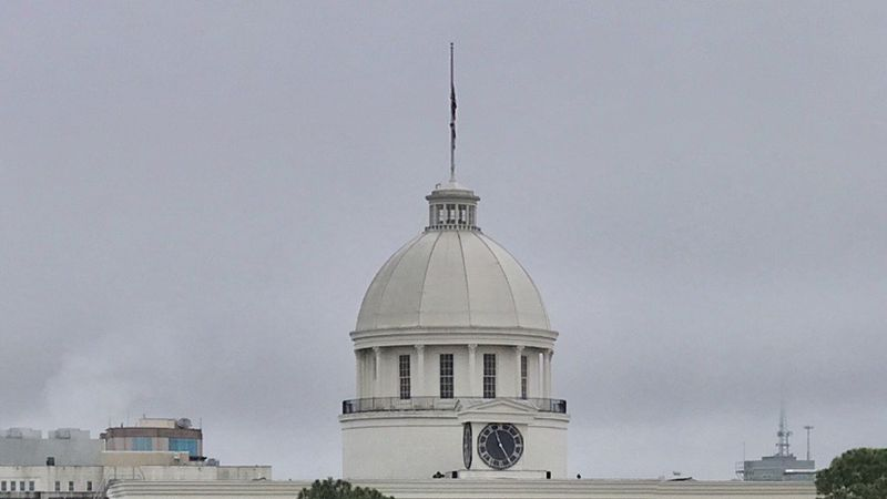 Despite no breeze to unfurl them on an overcast day, flags at the Alabama Capitol have been...