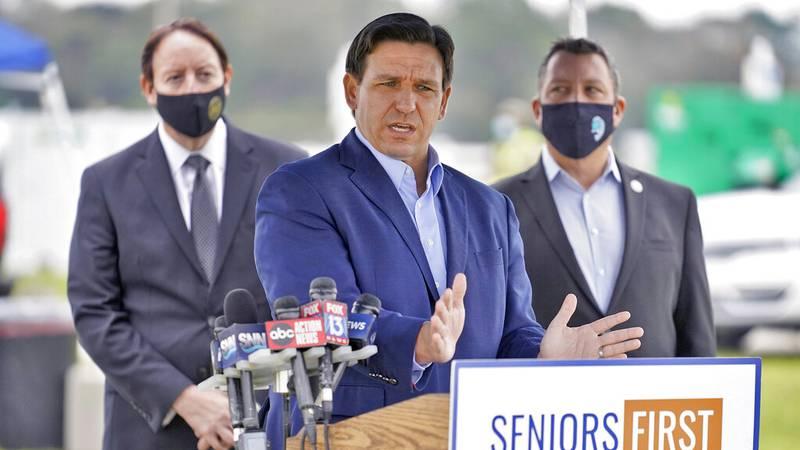 Florida Gov. Ron DeSantis speaks the media at a coronavirus vaccination site at Lakewood Ranch...