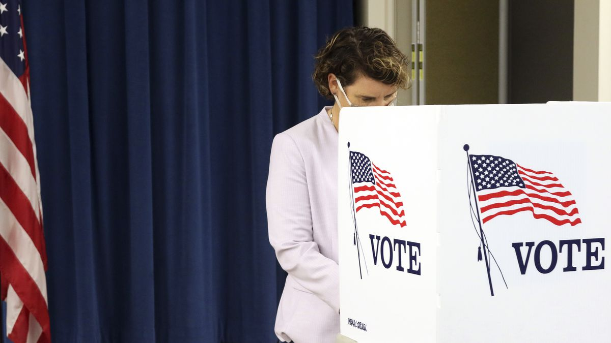 FILE - In this Tuesday, Oct. 13, 2020 file photo, U.S. Senate candidate Amy McGrath fills out...