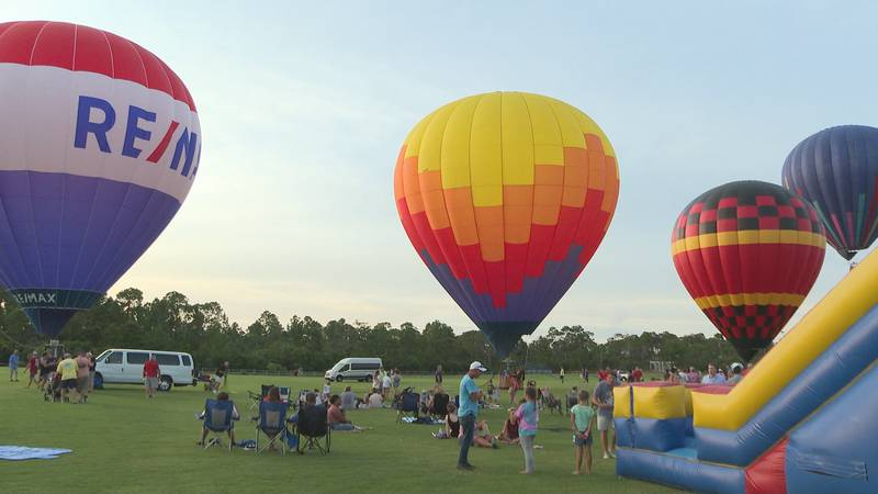 Hundreds gathered throughout Aaron Bessant Park to attend the Panama City Beach Balloon Glow...
