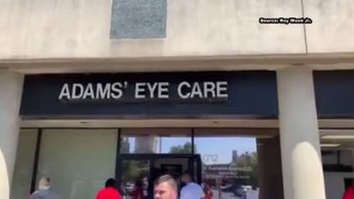Dozens of volunteers, including comedian Roy Wood Jr spent Monday cleaning up after vandals smashed the windows out at Adams Eye Care along historic 5th Avenue North. (Source: WBRC)