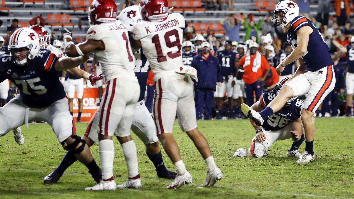 Auburn's Anders Carlson (26) kicks the go-ahead field goal against Arkansas during the second half of an NCAA college football game Saturday, Oct. 10, 2020, in Auburn, Ala. Auburn won 30-28. (AP Photo/Butch Dill)