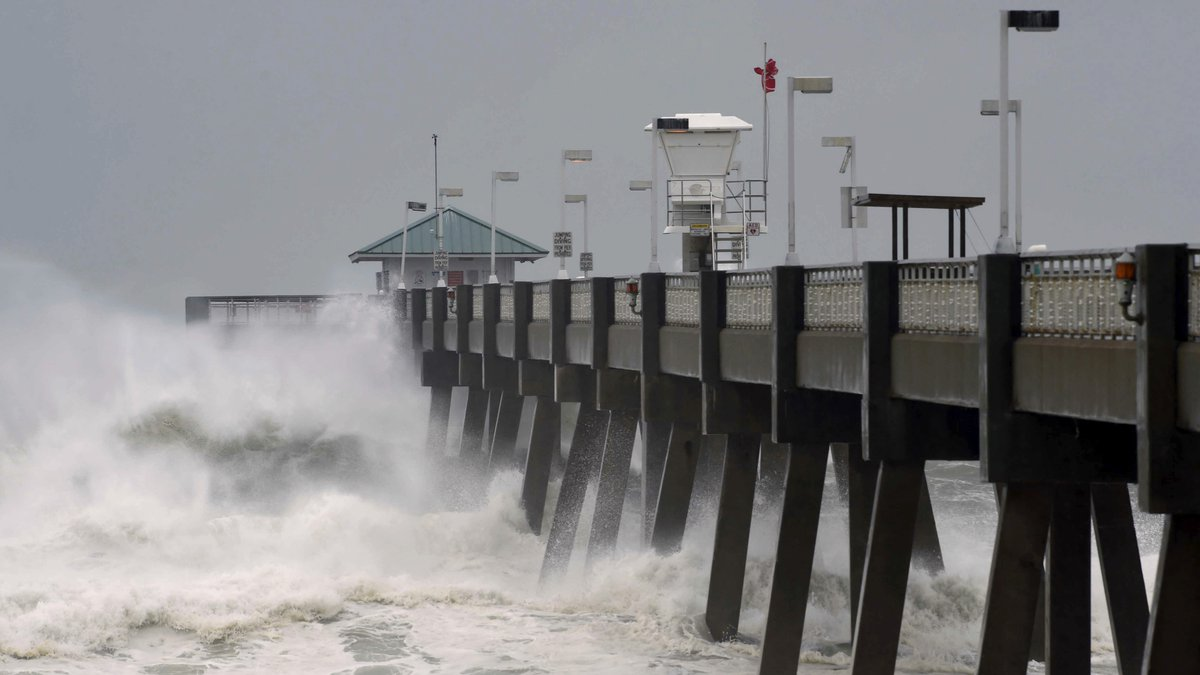 Heavy surf from the approaching Hurricane Michael pounds the fishing pier on Okaloosa Island...