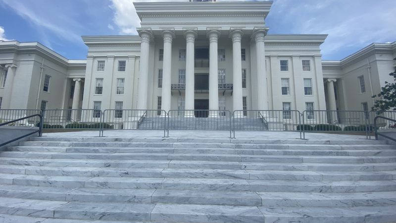 Metal barricades now line the Alabama State Capitol complex.