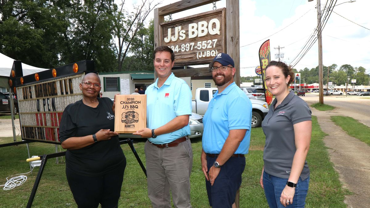 JJ's BBQ in Elba in Coffee County was a finalist in the Bama's Best Pulled Pork contest, sponsored by the Alabama Pork Producers. Judges were Josh Tubbs, a Walker County pig farmer; Russ Durrance, the Alabama Farmers Federation Pork Division director; and Mary Wilson, host of Simply Southern TV. They visited the restaurant July 15. From left are owner Chequita Walker, Durrance, Tubbs and Wilson.