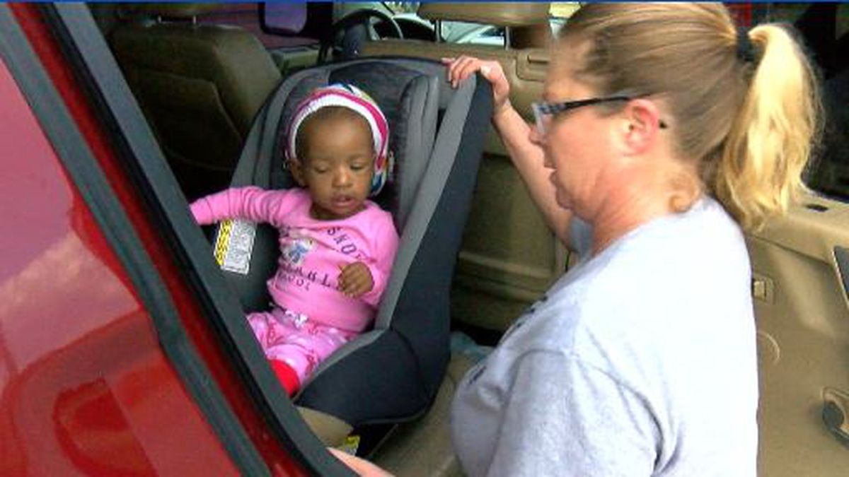 A mom secures her child in a car seat, but is that seat expired?
