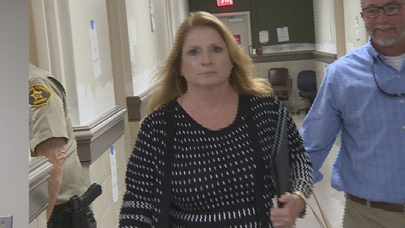 Gayla White leaves a Houston County courtroom following her preliminary hearing on theft...